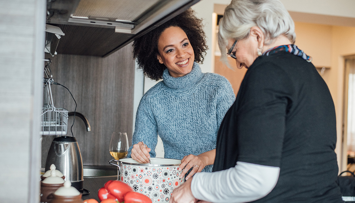 Two women preparing dinner together