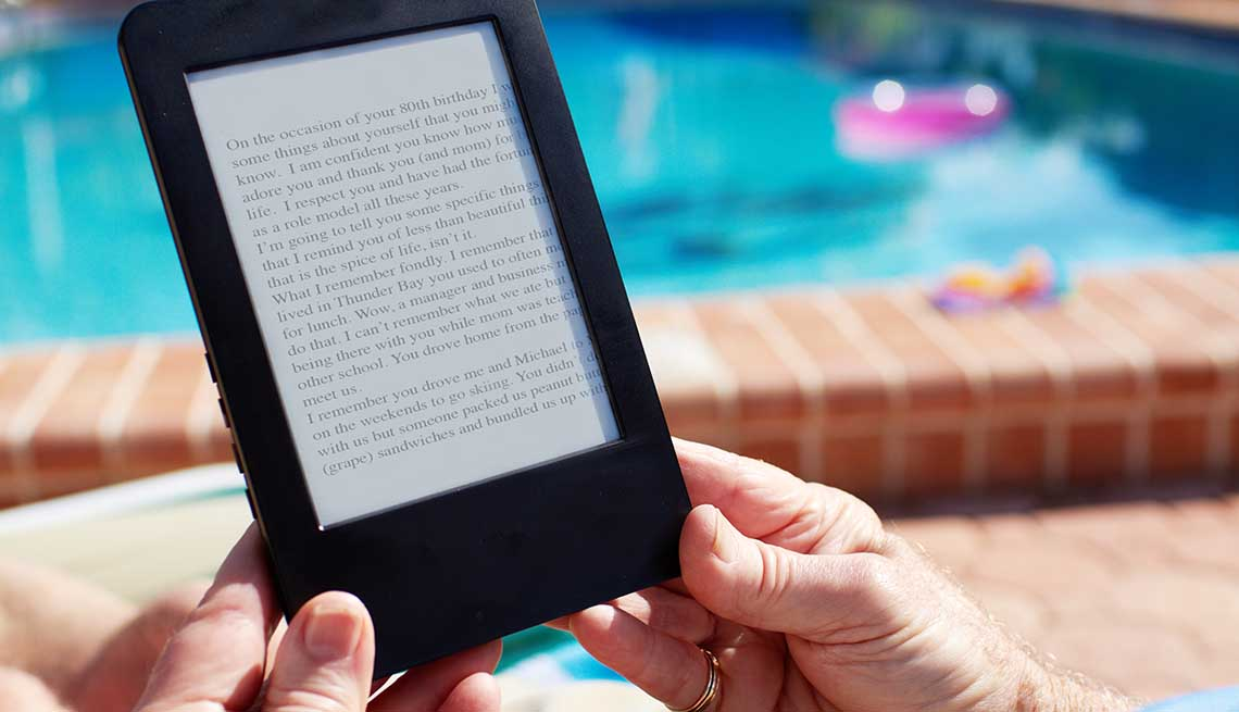 Older adult using an e-book reader