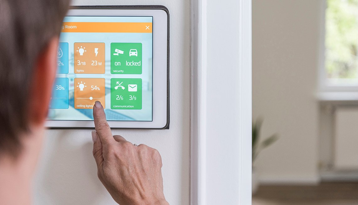 Woman changes ceiling lights on smart home device