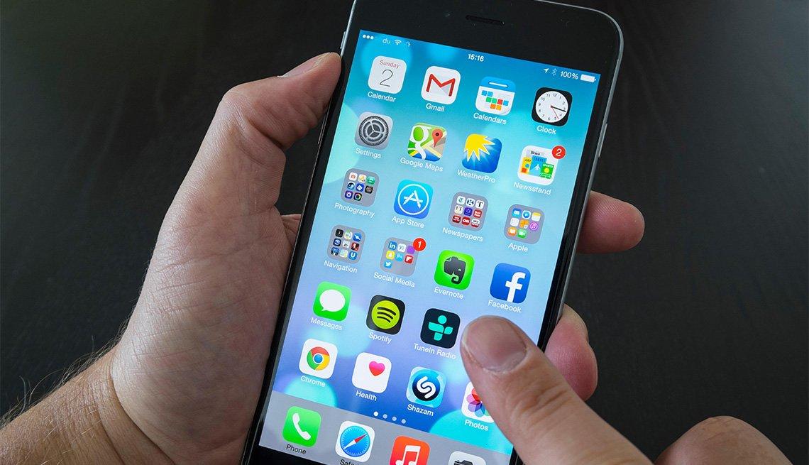 Close up of man using iPhone 6 Plus smart phone
