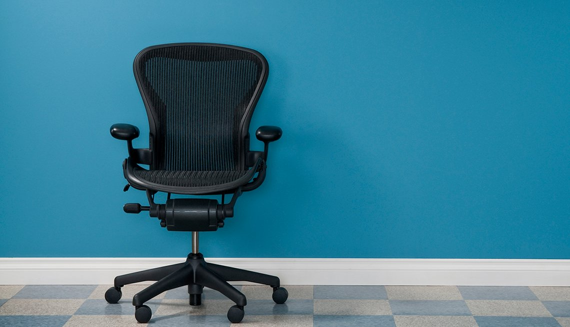 Single office chair in austere office.*