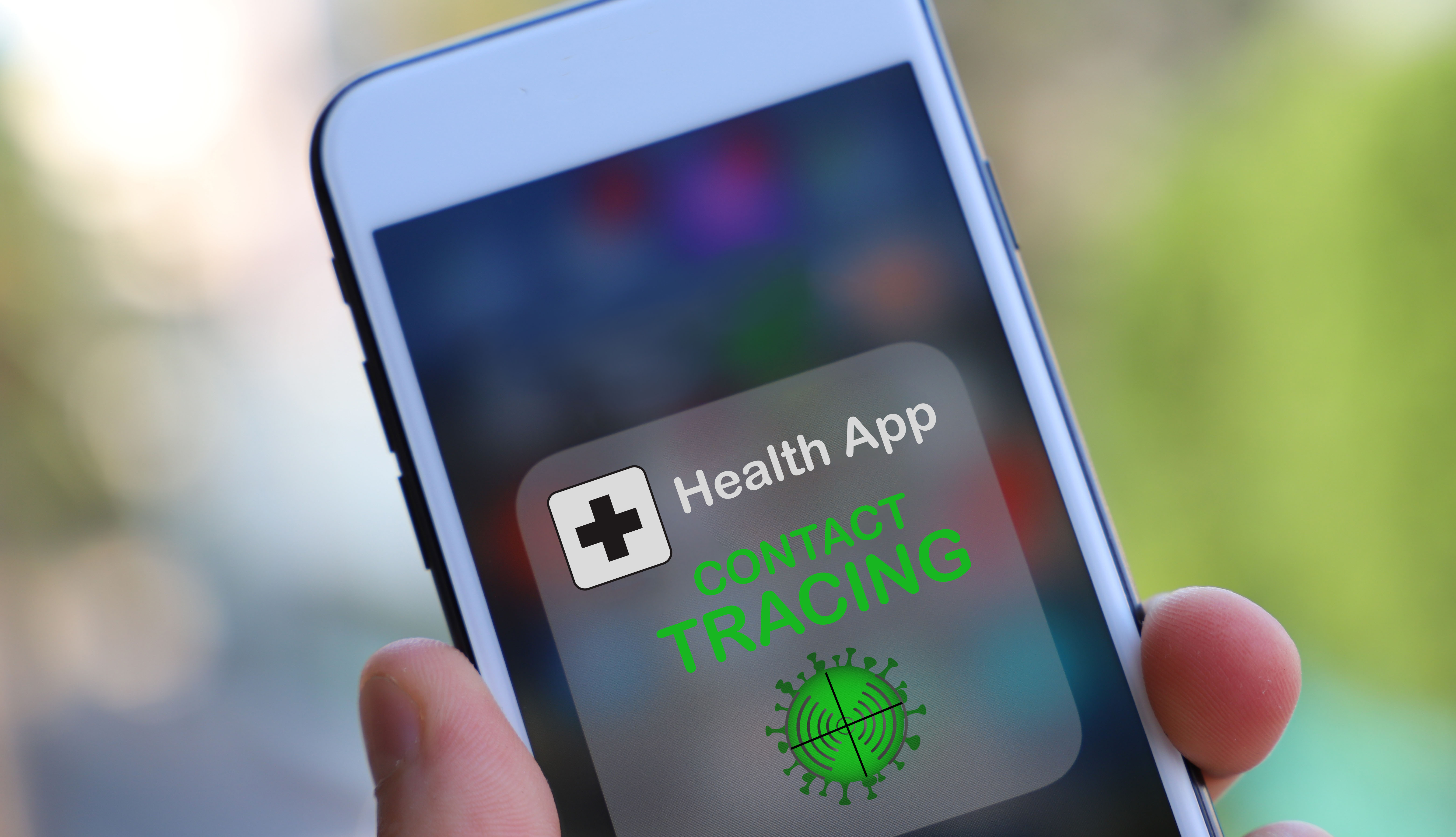 hand holding smartphone with a health app for contact tracing displayed on the phone screen
