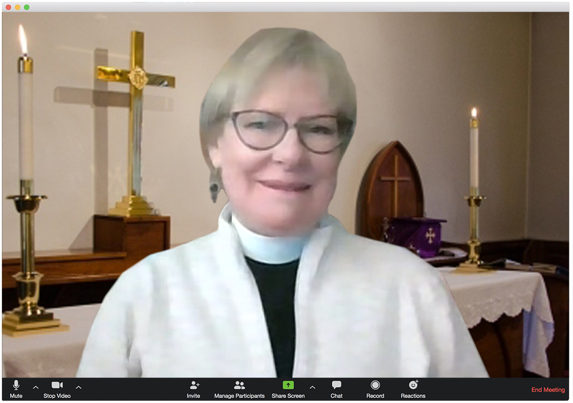a reverend in a church as appearing in a zoom meeting browser window