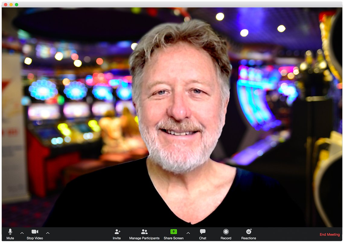 man as appearing on a zoom call in a browser window with casino background