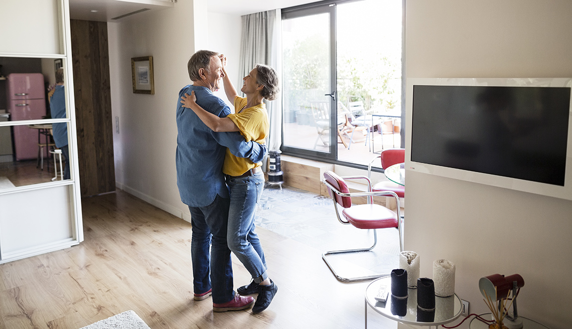 Couple dancing together while listening to music