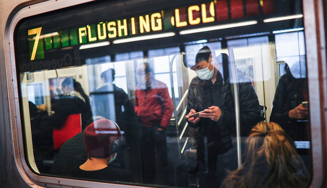 New York's mass transit agency wants Apple to come up with a better way for iPhone users to unlock their phones without taking off their masks, as it seeks to guard against the spread of COVID-19 in buses and subways.