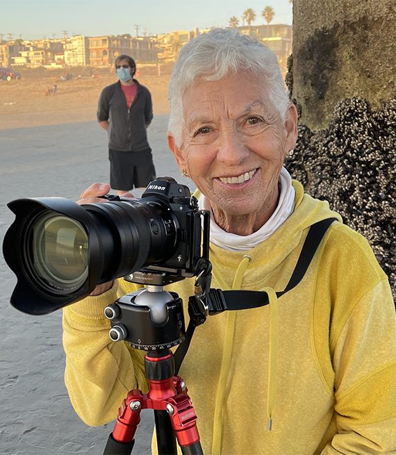 Evelyn Schmitt taking a posing with a digital camera