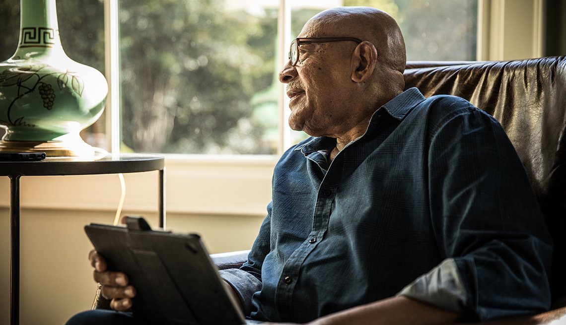 Older man using tablet