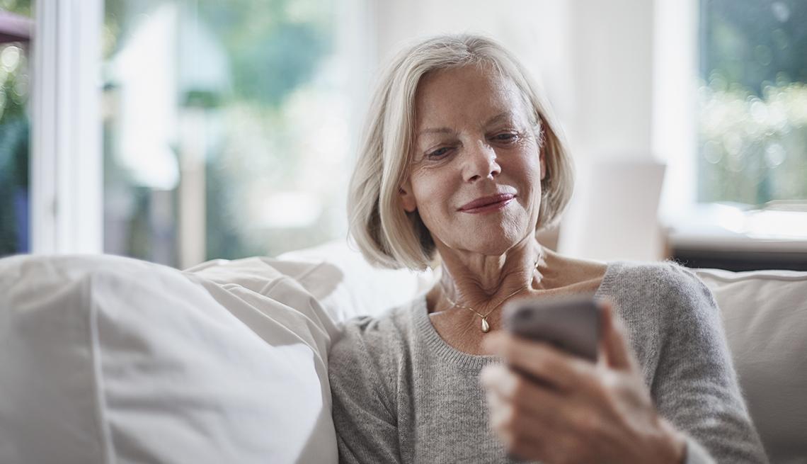 Woman staring at smartphone