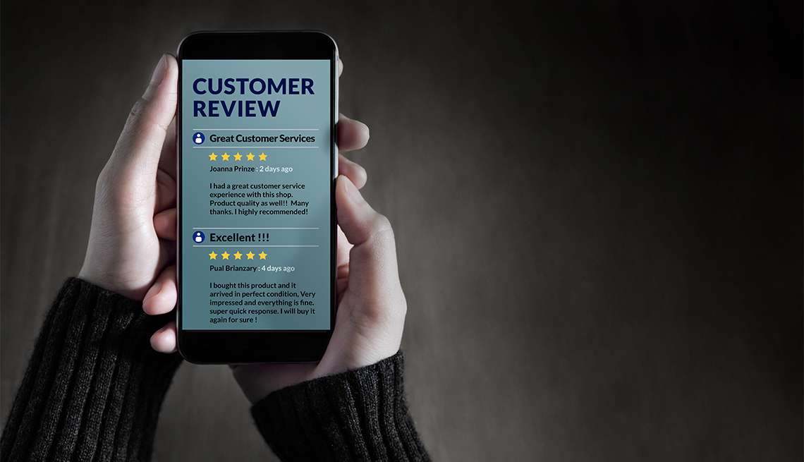 person reading reviews on smartphone