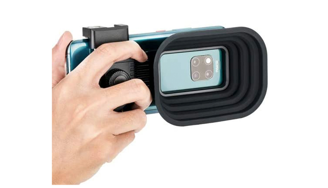 a j c c lens hood attached to a smartphone
