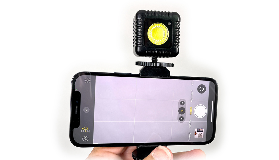 a Lume Cube light attached to the top of a smartphone