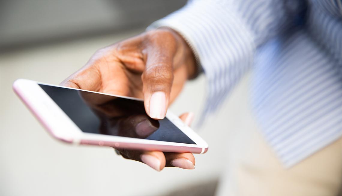 Closeup of women's hands holding a smart phone
