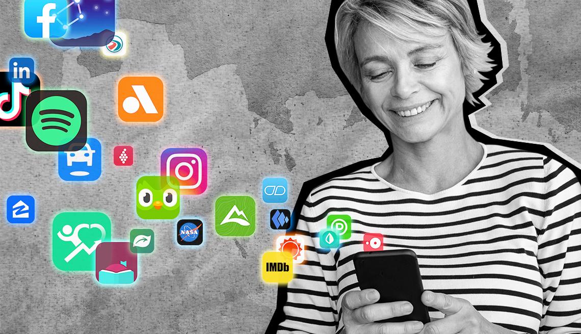 Una mujer mira aplicaciones flotando fuera de su teléfono celular