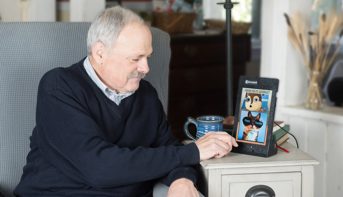 a man interacting with the care coach app on his tablet