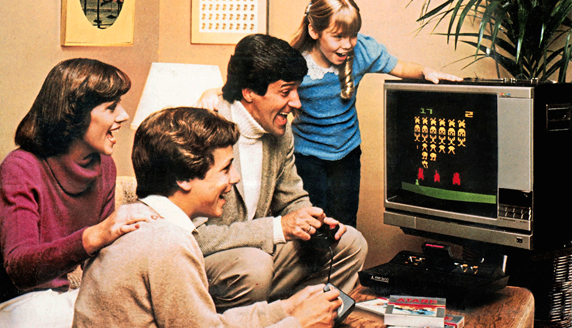 vintage photo from nineteen seventy eight of family playing space invader video game
