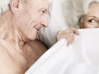 Senior Couple Flirting in Bed, Older Men- 6 Keys to Enhancing Erotic Arousal