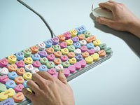 Man typing on computer keyboard candy hearts, Online Dating