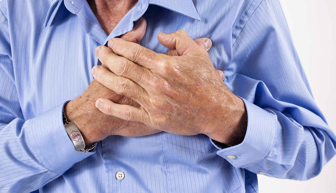 Middle Aged Man Clutches Chest, Can Sex Lead To A Heart Attack?