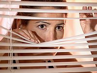 Woman peering through blinds, Jealousy