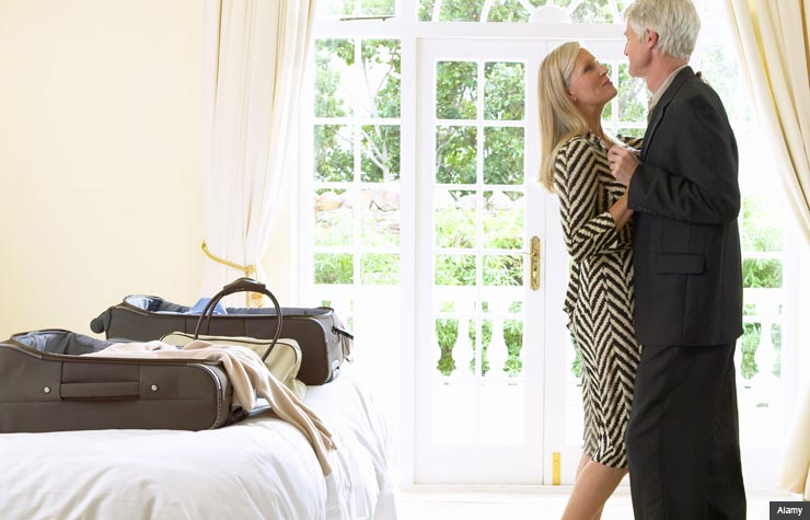 Couple in hotel room. Should you consider a hall-pass for your marriage?