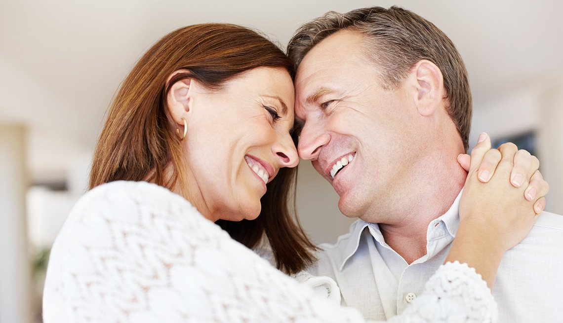 Mature Couple Smile And Touch Foreheads As They Hug, AARP Home And Family, Sex And Intimacy, Popular Erection Drugs Other Than Viagra