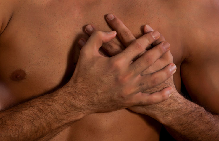 African-American man clutches his chest, Can Sex Cause a Heart Attack?