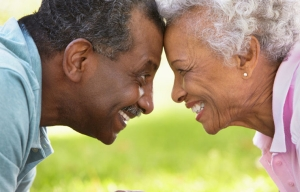 Portrait Of Romantic Senior African American Couple In Park