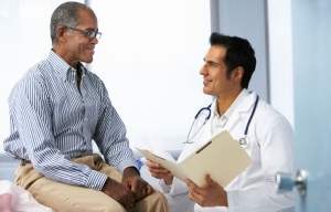Doctor talks With Male Patient, PSA cancer Testing
