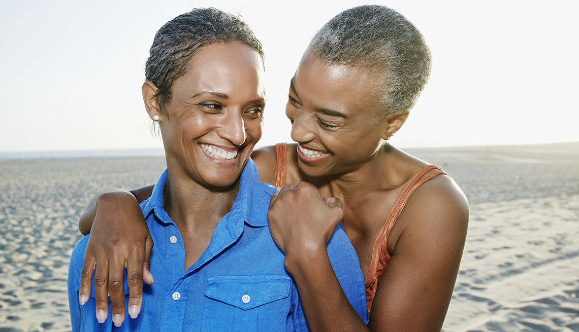 Two African American Ladies Embrace On Beach, Can Sexual Preference Change Over Time?