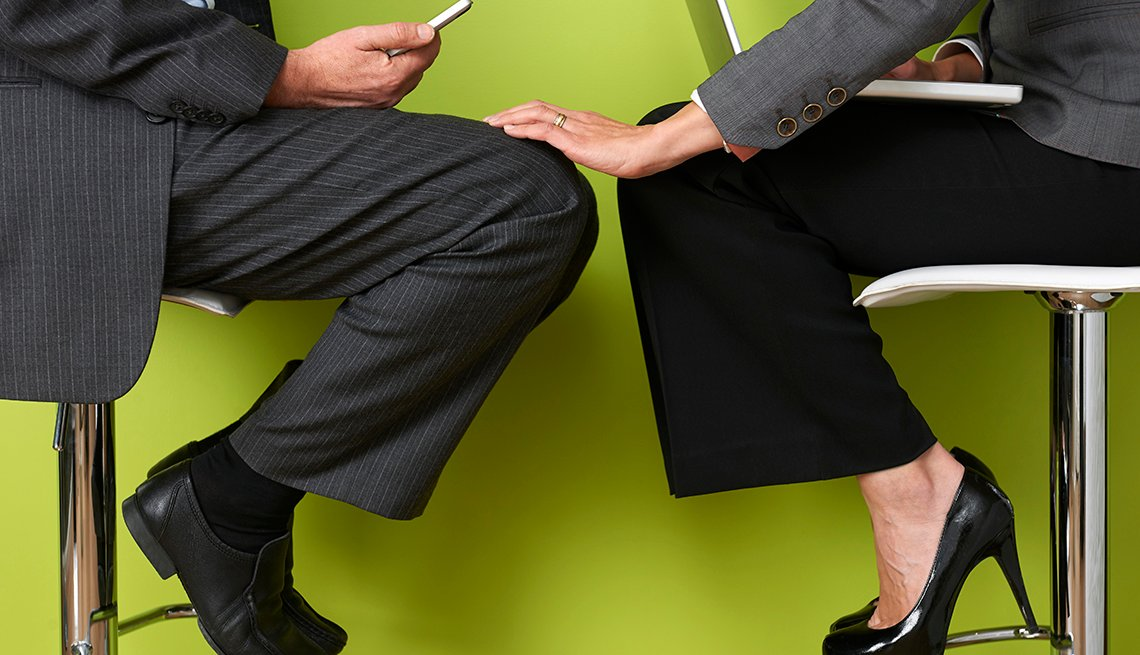 Woman Touching Coworkers Leg, Closer to Coworker Than Spouse