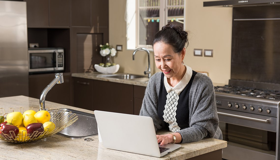 Fashionable mature woman using laptop