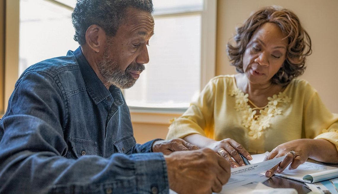 Man and woman reviewing insurance paperwork