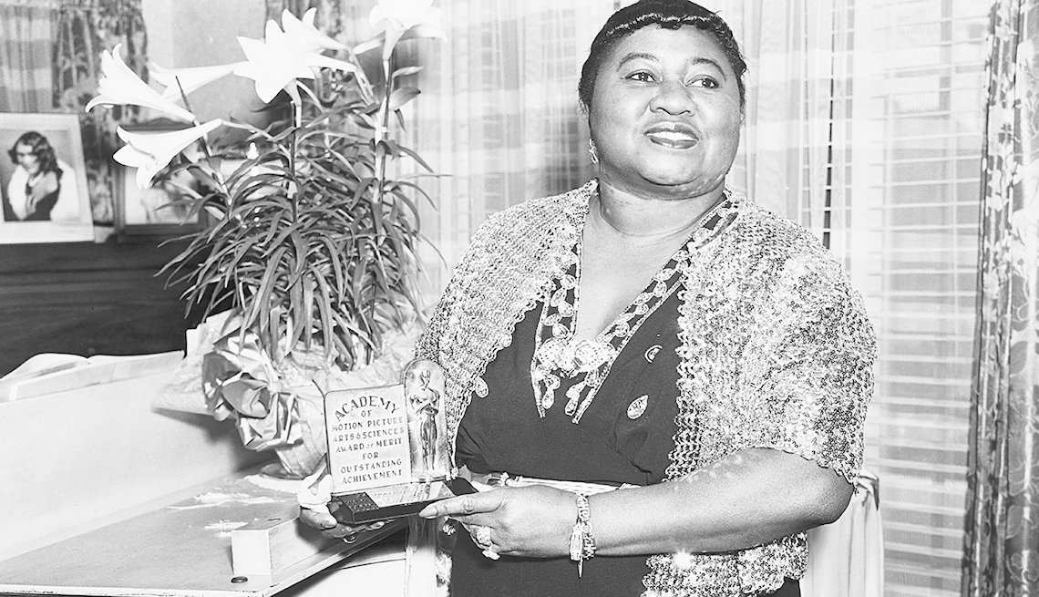 American actress Hattie McDaniel (1895 - 1952) with her Academy Award of Merit for Outstanding Achievement, circa 1945. McDaniel won an Oscar for Best Supporting Actress for her role of Mammy in 'Gone With The Wind', making her the first African-American