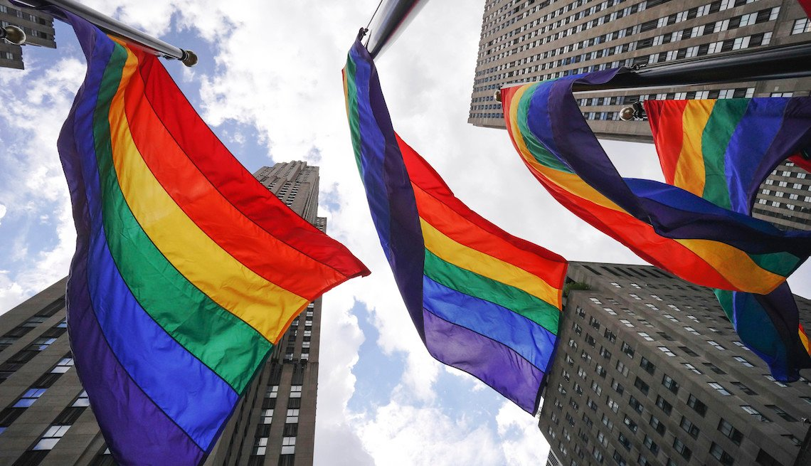 Rainbow flags fly in Rockefeller Plaza in New York City on June 26, 2020 to celebrate International LGBT Pride Day