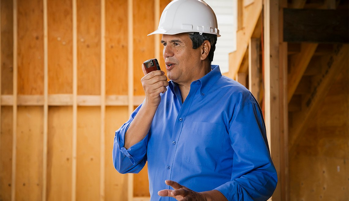 Native American construction worker talking on cell phone