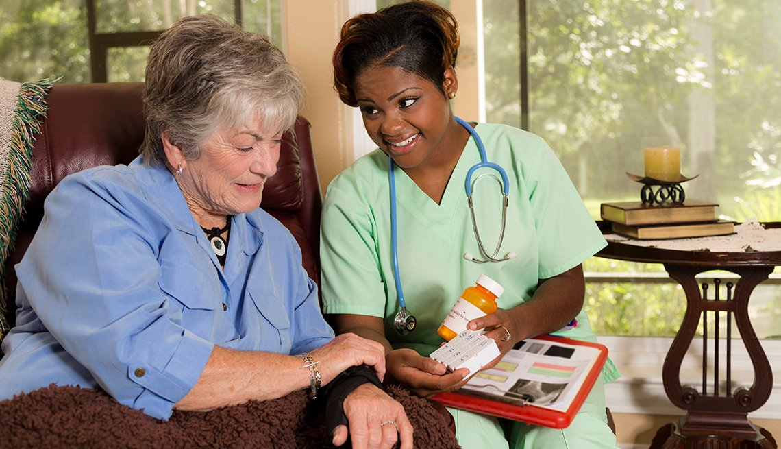 nurse showing woman prescriptions