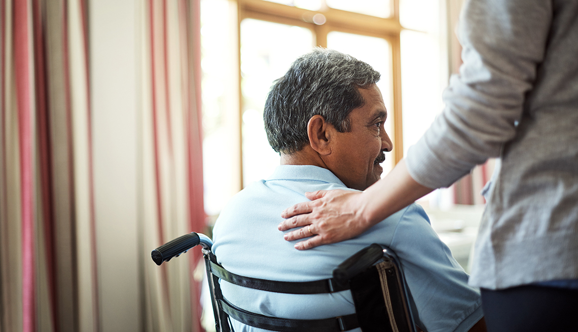 A nurse caring for a senior man