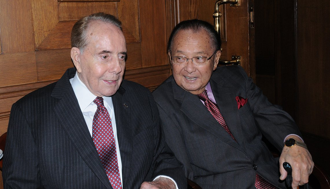 Senator Bob Dole, left, sitting with Senator Daniel Inouye