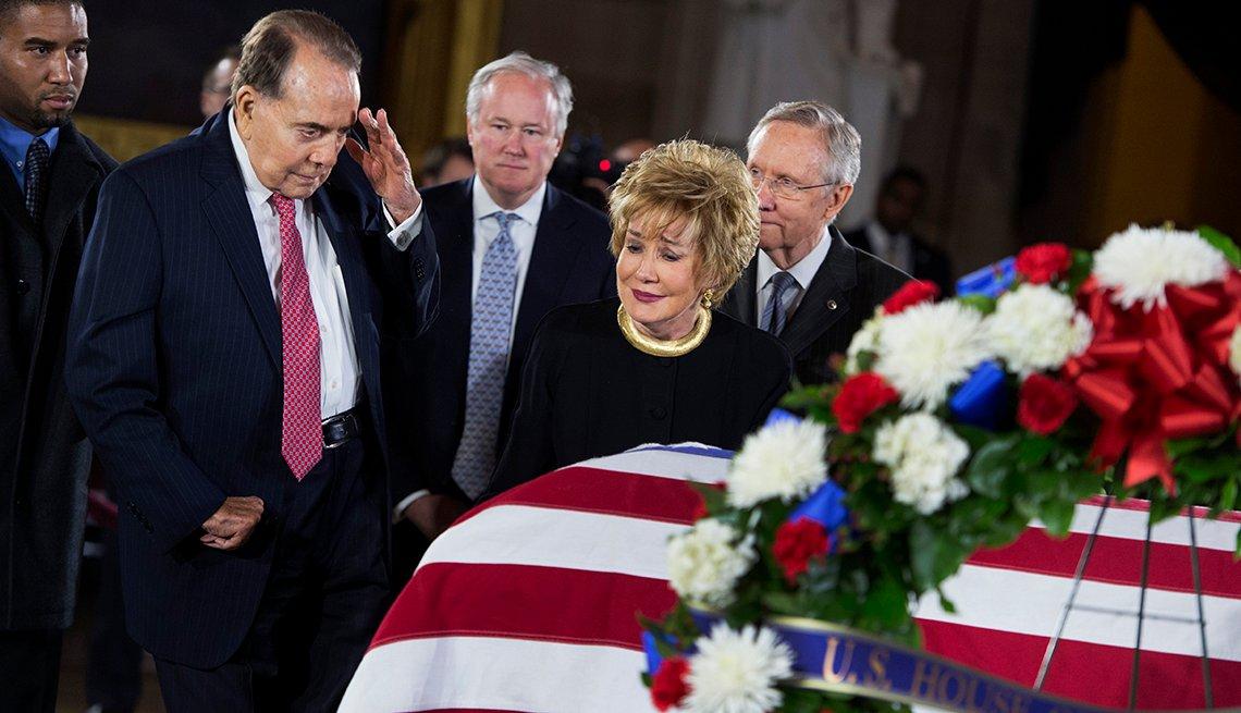 Bob Dole salutes the casket of Daniel Inouye