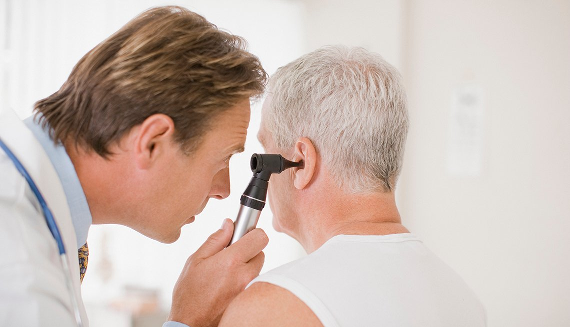 Man getting his hearing checked by a doctor
