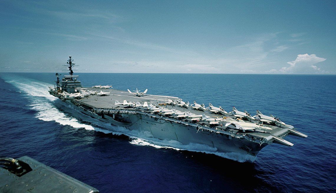 Aerial views of the aircraft carrier USS Constellation at sea. Photograph taken on September 3, 1966