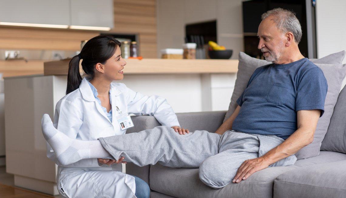 Doctor visits a Hispanic disabled veteran at home