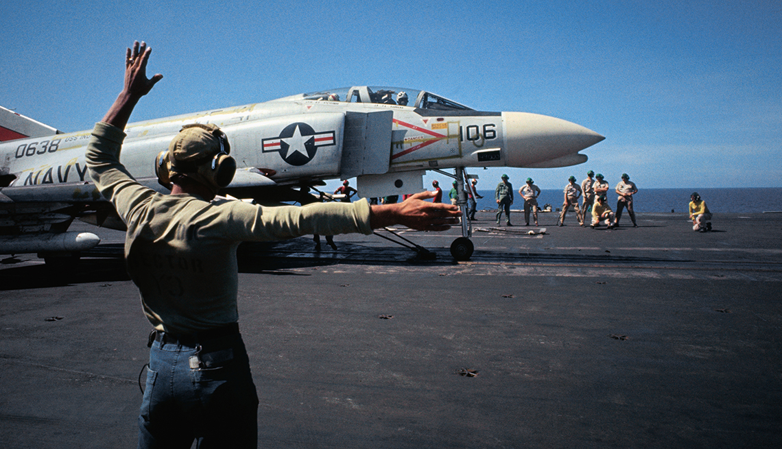 A plane is getting ready to take off from an aircraft carrier