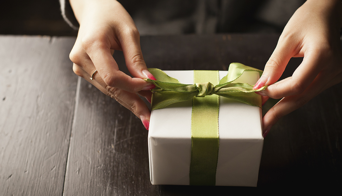 Woman Ties Bow On A Gift, AARP Home And Family, Queen Of Clutter