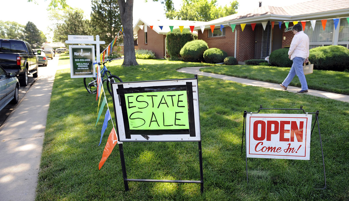 Signs For An Estate Sale On A Yard Outside Home, AARP Home And Family, Queen Of Clutter