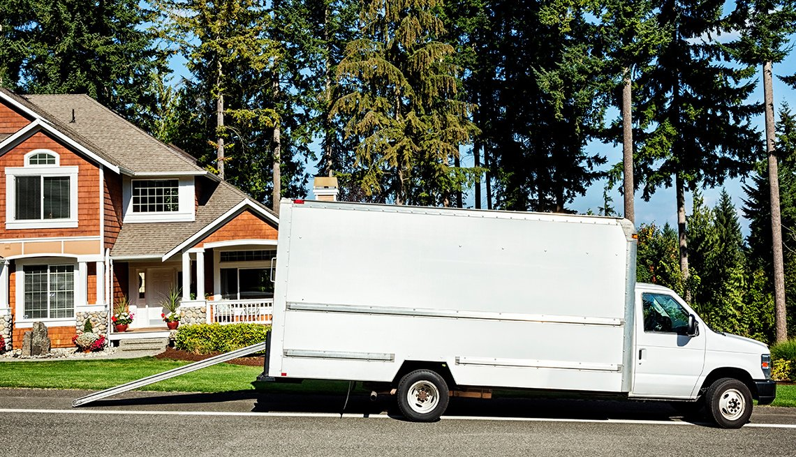 Moving van in front of house