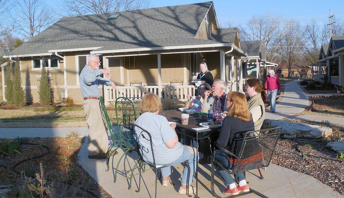 Residents of Oakcreek Community meet outdoors on a sunny day
