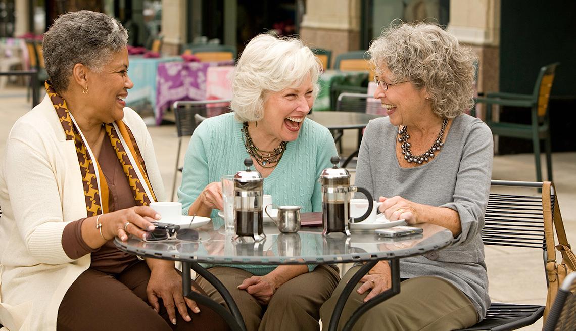 three senior women drinking coffee