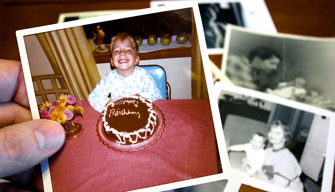Vintage photo of boy and birthday cake
